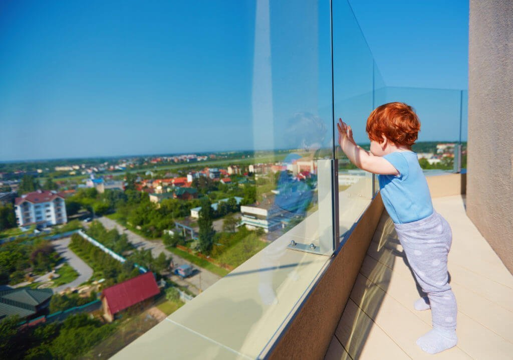 Glass railing with child