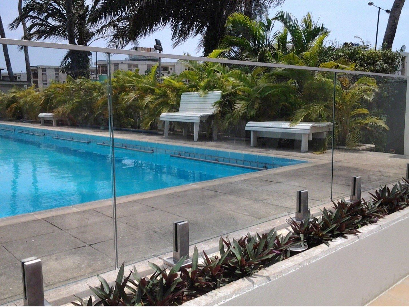 Glass railing around outdoor pool